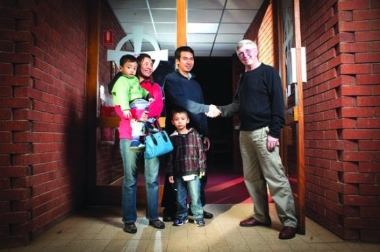 MIGRANT HANDSHAKE: Salisbury parishioner Gerry Moore welcomes to  St Augustine's Church new refugees from Burma John Mung, his wife Mary Zo Nu and their sons James Lian and Peter Thang.  Photo: Nat Rogers