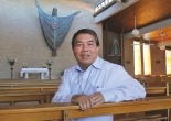 Caption:  ALL IN GOOD TIME: Deacon Long Hai Nguyen at St Mary Margaret's Church where he will say his first Mass as a priest later this month.