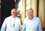 Caption: BENEFACTOR: Robert Stigwood (right) with the late Brother Columbanus outside Paringa Hall when he visited Sacred Heart College on December 30, 2004.