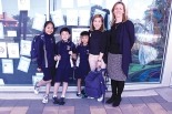 Caption: SCHOOL'S IN: St Brigid's Kilburn students Jasmine, James and Jones with their mother Nhung and principal Trish O'Toole.